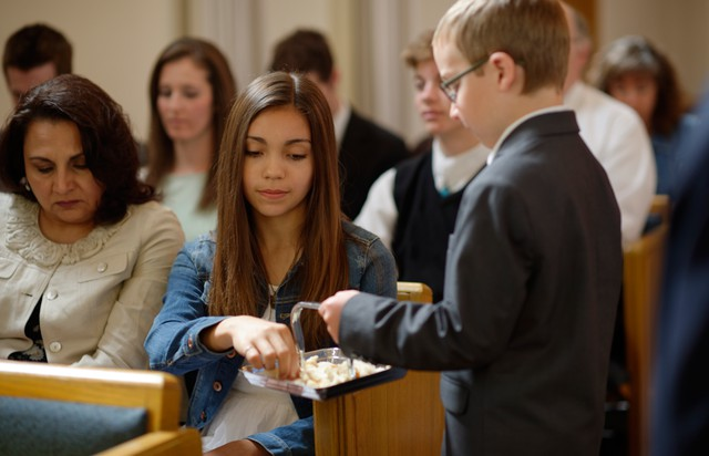 Why is it the practice in the Mormon Church to take the sacrament with the right hand?
