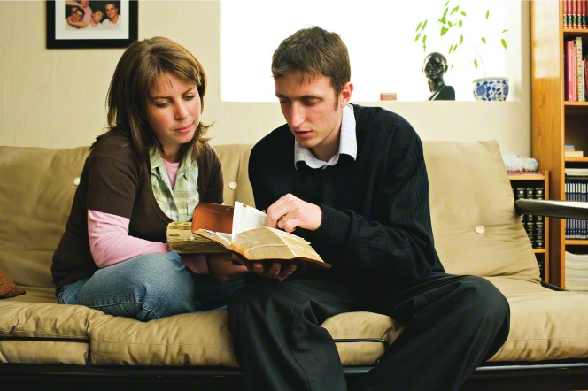 couple studying scriptures