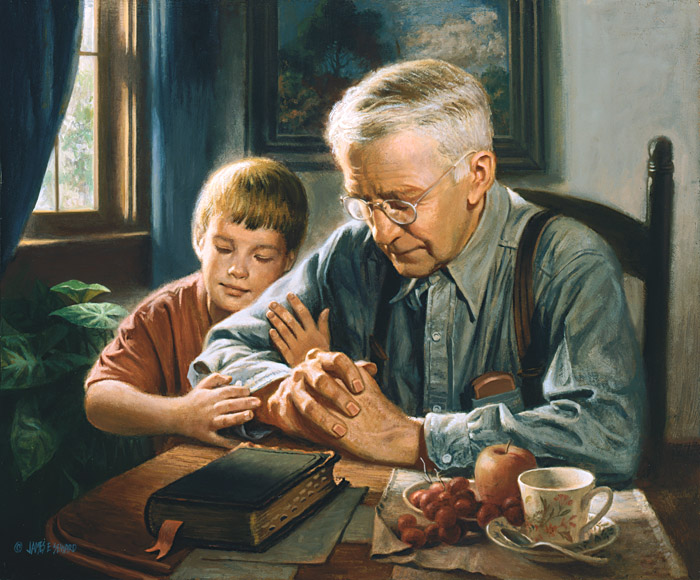 grandfather and grandson praying