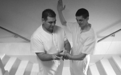 Why is our current baptismal prayer different than the one Peter stated in Acts?