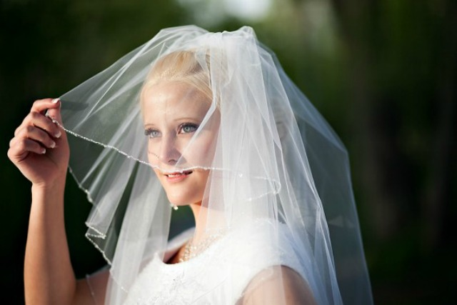If a woman broke the Law of Chastity, can she still wear a veil during a marriage ceremony?