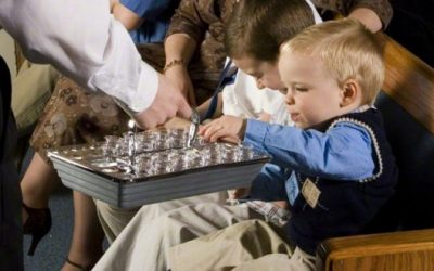 What is the correct posture or stance for passing the Sacrament?