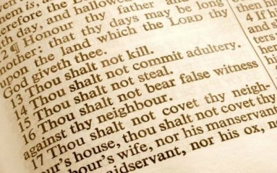 What is the difference between a law and a commandment?